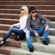 Young couple in conflict sitting on the steps — Stock Photo