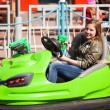 Stock Photo: Teenage girl driving bumper car