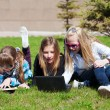 Stock Photo: Teenage schoolgirls lying on grass