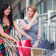 Stock Photo: Young women with shopping cart
