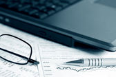 Financial graphs and charts analysis — Foto de Stock