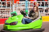 Teenage girl driving a bumper car — Stock Photo