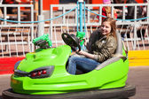 Teenage girl driving a bumper car — Stock Photo