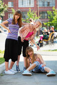 Teenage girls having fun on the playground — Stok fotoğraf