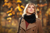 Happy blond woman in autumn forest — Stock Photo