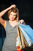 Young woman with shopping bags — Photo