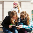 Teenage schoolgirls on the steps of campus — Stock Photo