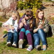 Stock Photo: Teenage girls eating an ice cream