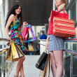 Young women with shopping bags — 图库照片