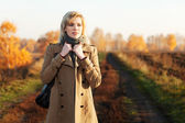Blond woman against an autumn nature landscape — Stock Photo
