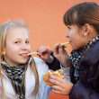 Stock Photo: Teenage girls eating a burgers