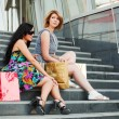 Two young women with shopping bags — ストック写真