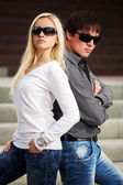 Young fashionable couple on the steps — Foto Stock