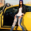 Fashionable punk woman standing at the car — Stock Photo