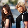 Two young women walking on a city street — Stock Photo #36693735