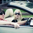 Young couple driving convertible car — Stock Photo