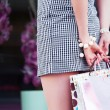 Female hands holding a shopping bags — Stock Photo