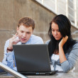 Stock Photo: Young couple working on laptop
