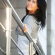 Woman leaning on the handrail — Stock Photo