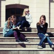 Schoolgirls on the steps — Stock Photo