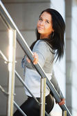 Woman leaning on the handrail — Stockfoto