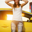 Angry fashionable punk woman standing at the car — Stock Photo #42064707