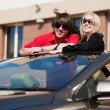 Happy young couple in convertible car — Stock Photo #42065195