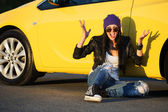 Angry fashionable punk woman sitting at the car — Stok fotoğraf