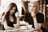 Young women eating an ice cream — Stock Photo