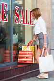 Young woman with shopping bags — Stock Photo