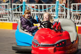 Teenage girls driving a bumper cars — Stock Photo