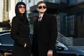 Young business couple against office building — Стоковое фото