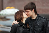Happy young couple in love kissing outdoor — Stock Photo