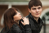 Happy young couple in love outdoor — Стоковое фото
