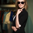 Young fashionable woman in the mall interior — Stock Photo