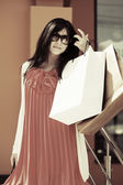 Happy young woman with shopping bags — Foto de Stock