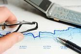 Financial graphs and charts analysis — Stock Photo