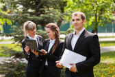 Young business people in a city park — Stock Photo