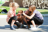 Teenage girls with a puppy — Stock Photo