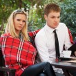 Young couple at a sidewalk cafe — Stock Photo #44383041