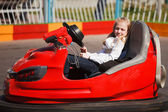 Teenage girl sleeping in a bumper car — Stock Photo