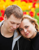 Happy young couple against a nature background — Stock Photo