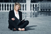Young business woman with a folder — Stock Photo