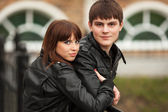 Happy young couple in leather jackets outdoor — Stock Photo