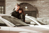 Happy young couple in love at the car — Stock Photo