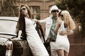Young couple and jealous girl at the retro car — Stock Photo