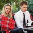Young couple at a sidewalk cafe — Stock Photo #46392221