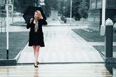 Woman with umbrella in the rain — Stock Photo