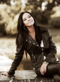 Young fashion woman in leather jacket — Stock Photo