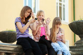 Group of school girls calling on the cell phones — Stock Photo